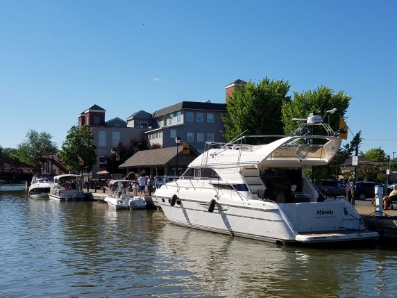 Several boats tied up to the dock on a sunny day in Fairport, NY